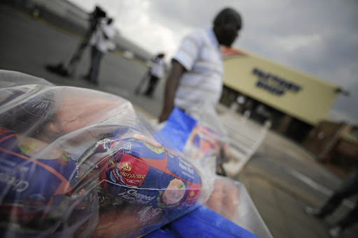 Businessman Phillip Sibia queues to return meat from the Enterprise Factory store in Germiston, east of Johannesburg. This comes after health authorities said they had traced the world's worst outbreak of listeriosis to Enterprise processed-meat factories in Polokwane and Germiston. Picture: Alaister Russell