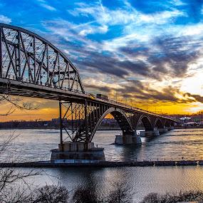 Peace Bridge Sunset by John Witt - Buildings & Architecture Bridges & Suspended Structures ( clouds, sky, sunset, niagara river, peace bridge,  )