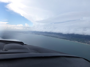 Photo: Flying past a storm over Naples