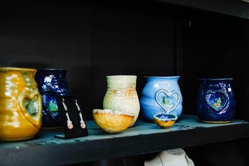 Betty Blu Pottery: Pottery on shelf with earrings
