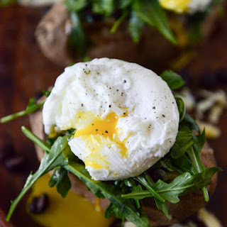 Black Bean, Arugula + Poached Egg Stuffed Sweet Potatoes.