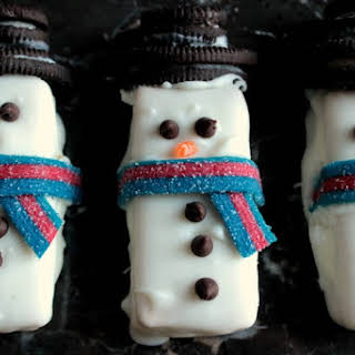 Chocolate Covered Snowman S'more Sandwiches.