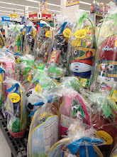 Photo: They had LOTS of premade Easter baskets near the front. They had them for all price ranges -- either $6.99, $9.99, or $15.99. I'm going to be buying a premade basket during my shopping trip, so I stopped by this display to see what they had. Most of all the ones on here included toys for either boys or girls, but I was hoping to find one with an Easter plush inside. I'll keep looking...