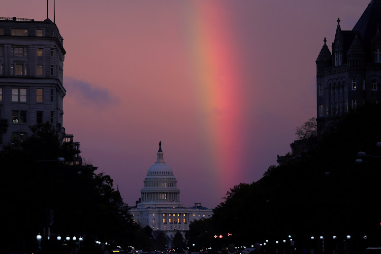 A rainbow forms over the US Capitol as evening sets on midterm election day in Washington DC.