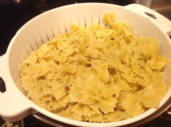 While meat is simmering cook pasta until al dente, according to package directions. Drain...