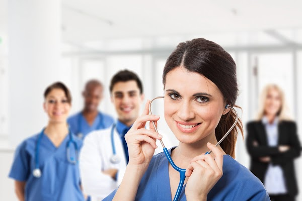 Portrait of a smiling nurse in front of a medical team