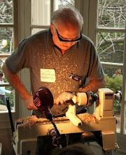 Photo: Eliot Feldman making tops...