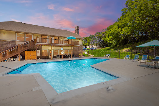 Hunters Glen's swimming pool next to clubhouse with lounge chairs