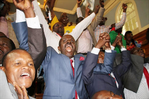 Knut secretary general Wilson Sossion and union members celebrate at the Supreme Court in Nairobi in August, after teachers were awarded a 50 to 60 per cent basic salary increment. Photo/FILE