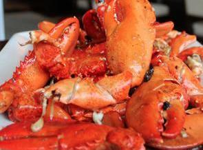 In the same skillet, cook the lobster claws overt high heat for several minutes...