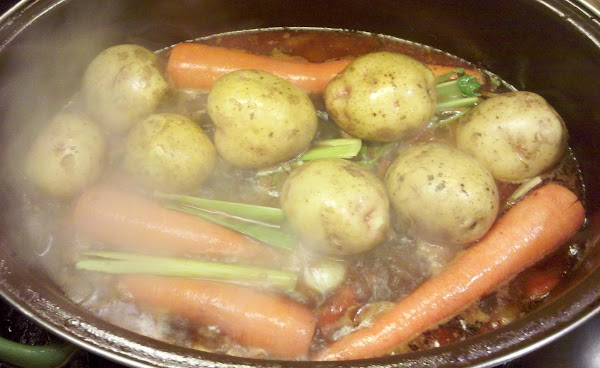 Then add back the rump roast to the boiling mixture. Then add potatoes, celery...