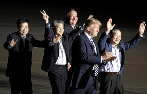 The three Americans held in North Korea, and Secretary of State Mike Pompeo, are greeted by US President Donald Trump upon their arrival on arrival at Joint Base Andrews, Maryland, on May 10 2018. Picture: REUTERS