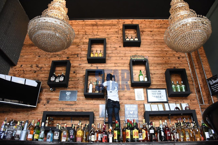 Sylvester Otiende a mixologist at Zipang bar dust alcoholic drinks in prepreparation of the reopening of bars on September 29,2020/ MERCY MUMO