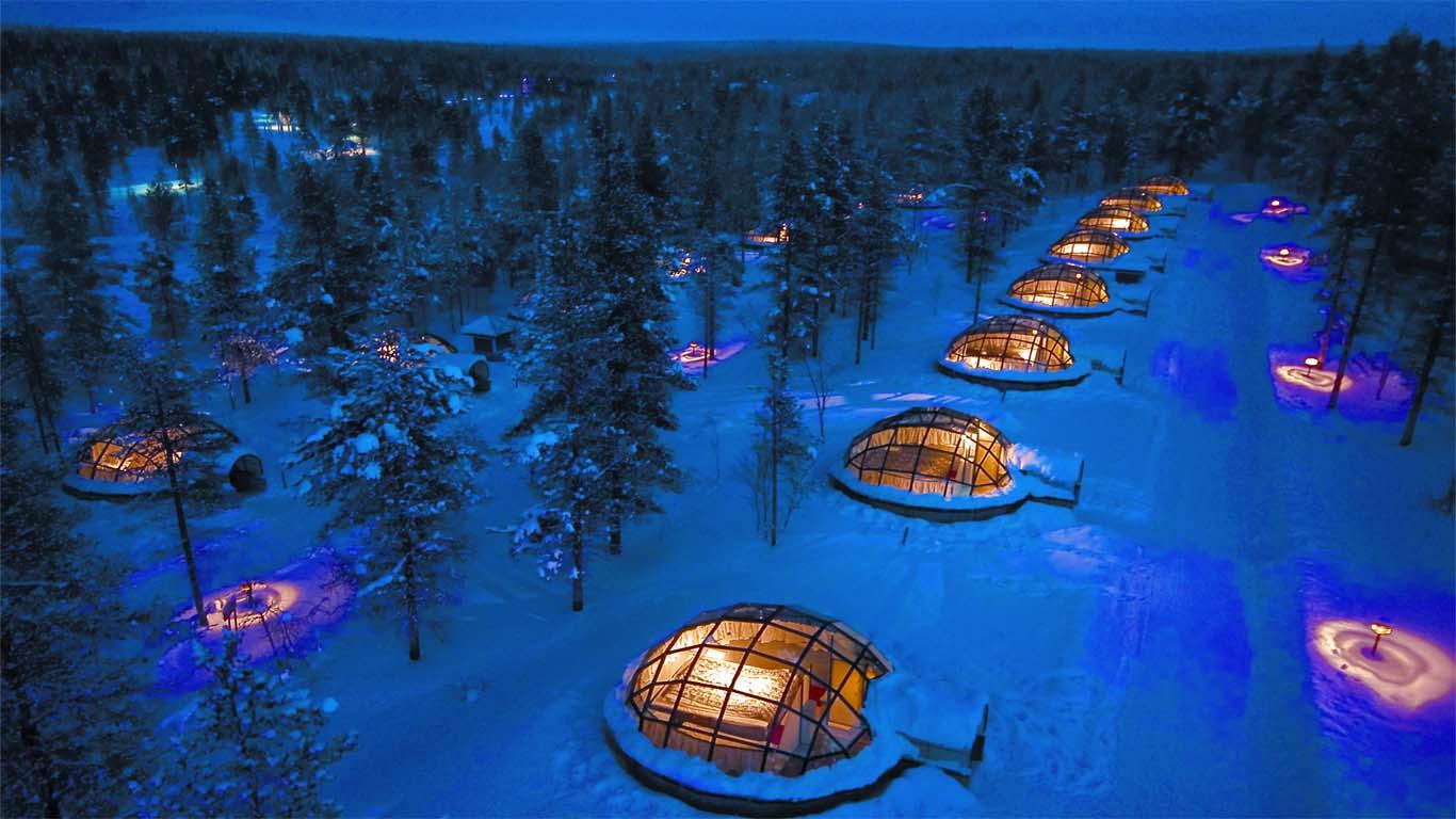 Rows of glass igloo houses illuminated at night
