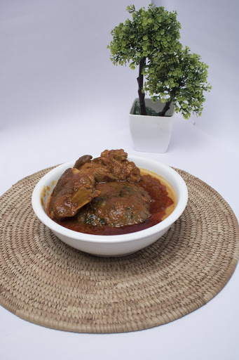 Amala served in a soup bowl with Ewedu, Gbegiri, and Tomato Stew