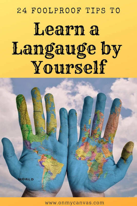 pinterest image for how to learn a language by yourself guide showing hands painted with world map