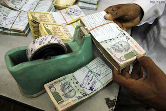 Photo: Economy, not corruption India's top worry: Survey http://t.in.com/2r4B