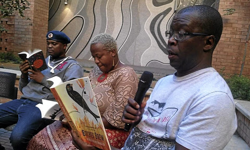 Niq Mhlongo, Zukiswa Wanner and Fred Khumalo promoting literature at the Sol Plaatje University in Kimberley, Northern Cape, one of the four cities they visited recently. / SUPPLIED