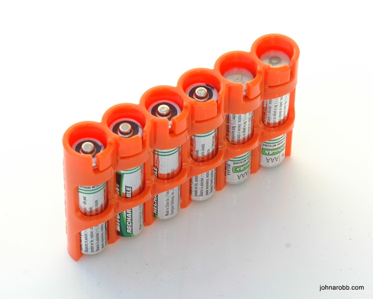 Photo: PowerPax slimline AAA Battery Caddy. Batteries display energy status by direction in battery caddy.