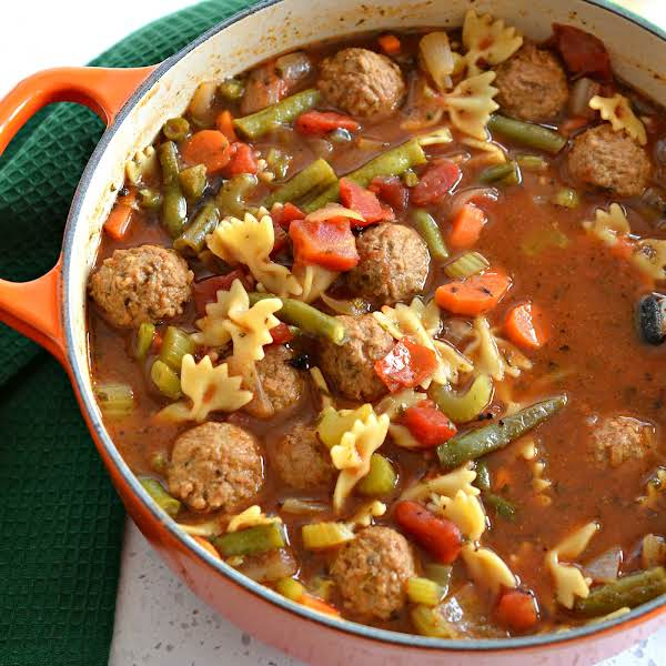 This Family Friendly Tasty Meatball Soup Is A Cinch To Make Using Frozen Or Fresh Meatballs And A Handful Of Fresh Cut Vegetables.  It Is Lightly Seasoned With Italian Spices In A Tasty Beefy Tomato Broth.