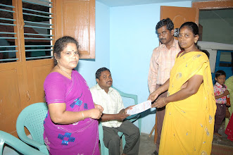 Photo: Certificate being distributed to a physically challenged youth by Mrs.Anjugam