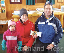 Photo: Medallion Winner Emma Trees with her parents Missy and Bryan  Trees.- photos by Mary Blexrud (photos merged and edited by  Northland Press)