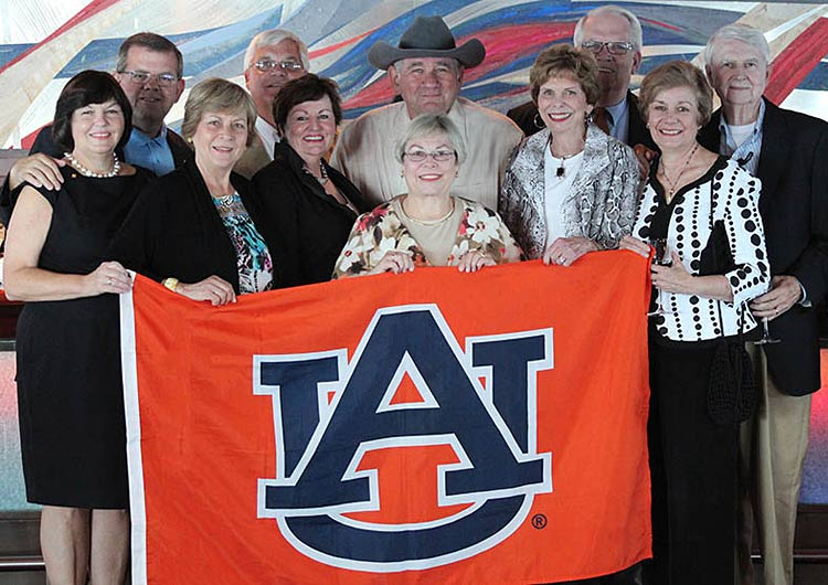 Auburn University alumni pose during a group cruise to the Baltic on Oceania Nautica.