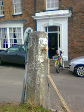 Photo: The last remaining railway memorablia - a level crossing post across the road from West St.