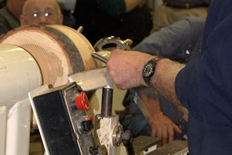 Photo: The bark is coming off (but not at the end toward the headstock, which will be the natural-edge rim), and the shape of the bottom is starting to be defined.