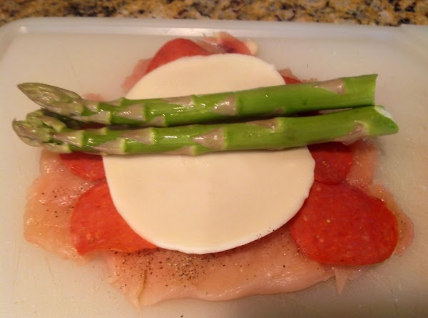 Add 3 asparagus spears in center of breast.