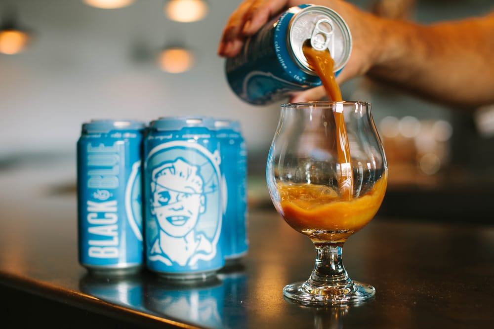 Photo of Cuvée Coffee Bar - Austin, TX, United States. Proudly serving black & blue, the world's first ever coffee on nitro. Try it on draft or in a can.