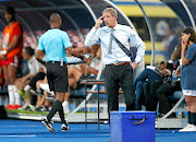 South Africa coach Stuart Baxter makes a remark to the assistant referee during Bafana Bafana match against Morocco.