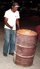 Photo: man spinning a barrel. cuba. Tracey Eaton photo.