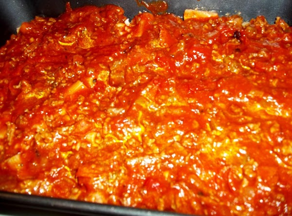 Now, spread about 2 cups of sauce over the cheese. Spreading evenly. ( This...