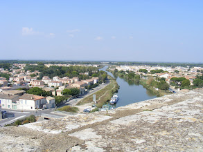 Photo: While there are still canals for smaller boats, the shifting Rhône delta in the mid-14th century left the town too far from the sea to continue as an important port.
