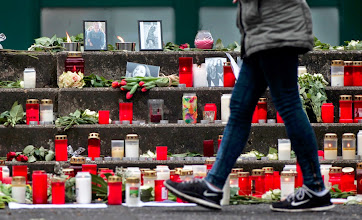 Photo: A girl walks past candles and photos in front of the Joseph-Koenig-Gymnasium high school in Haltern am See, March, 25, 2015. Students and teachers at a small-town German high school broke out in ears when they realised that 16 classmates and two teachers were on board an ill-fated Germanwings airplane that crashed in France on Tuesday on a flight home to Duesseldorf. An Airbus operated by Lufthansa's Germanwings budget airline crashed in a remote snowy area of the French Alps on Tuesday, killing all 150 on board including 16 schoolchildren.    REUTERS/Ina Fassbender  TPX IMAGES OF THE DAY