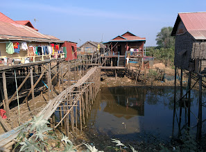 Photo: In the dry season the lake level falls, leaving these houses and walkways perched on spindly poles.