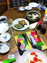 Photo: Hmmm.  Dinner.  Sashimi, yakitori, tsukune, boiled tofu, salad.
