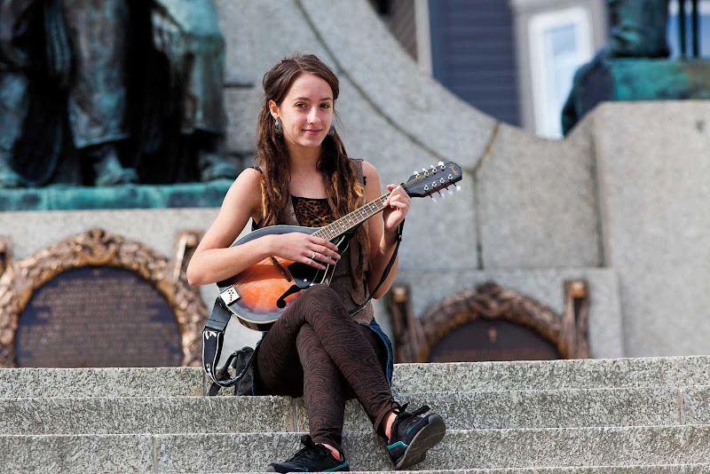 A busker, or street performer, at War Memorial in downtown St. John's, Newfoundland.