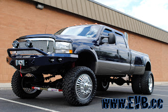 """Photo: 2003 Ford F350 with a skyjacker 8"""" coil system Road Armor bumpers with custom built 22"""" wheels"""