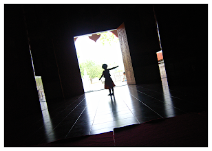 Photo: Temple Games  This is my step-daughter 'Kaem' playing in a darkened temple in Omkoi. I just happened to turn around as she was framed by the giant doorway. The camera did the rest.