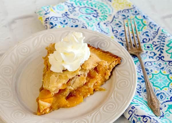 A Slice Of Alabama Peach Pie On A Plate.