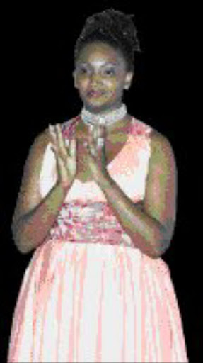 PROMOTED: Former editor Busi Mahlaba. 23/07/07. Sowetan.  FUNNY LADY: Editor Busi Mahlaba's dress sense could do with a bit of editiing. It's true love. Pic. Peter Mogaki. 10/11/05. © Sunday World.
