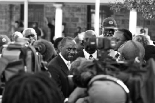 TELL US: National Director of Public Prosecutions Menzi Simelane addresses the media outside the court the case was postponed to April 14. Pic. Bafana Mahlangu. 06/04/2010. © Sowetan.