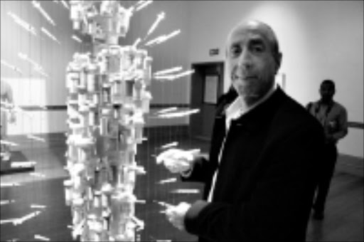 MASTERPIECE: Daniel Goldstein collect containers of his ARV drugs and injections to spread awareness about the pandemic.  Cicra 2008.  Pic. Unknown.