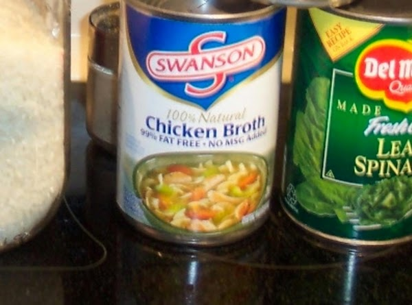 When the carrots are done add the cooked rice, and the cut up canned...