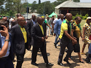 ANC president Cyril Ramaphosa and former president Jacob Zuma greet members of the community whilst on their way to the wreath laying ceremony at Ohlange Institute in Inanda, north of Durban.