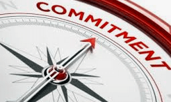 compass arrow pointing to the word commitment on the dial