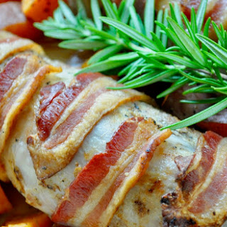 Bacon Wrapped Pork Tenderloin with Roasted Sweet Potatoes.