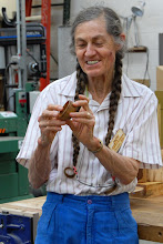 Photo: Margaret talks about the carving she did on the bowl.